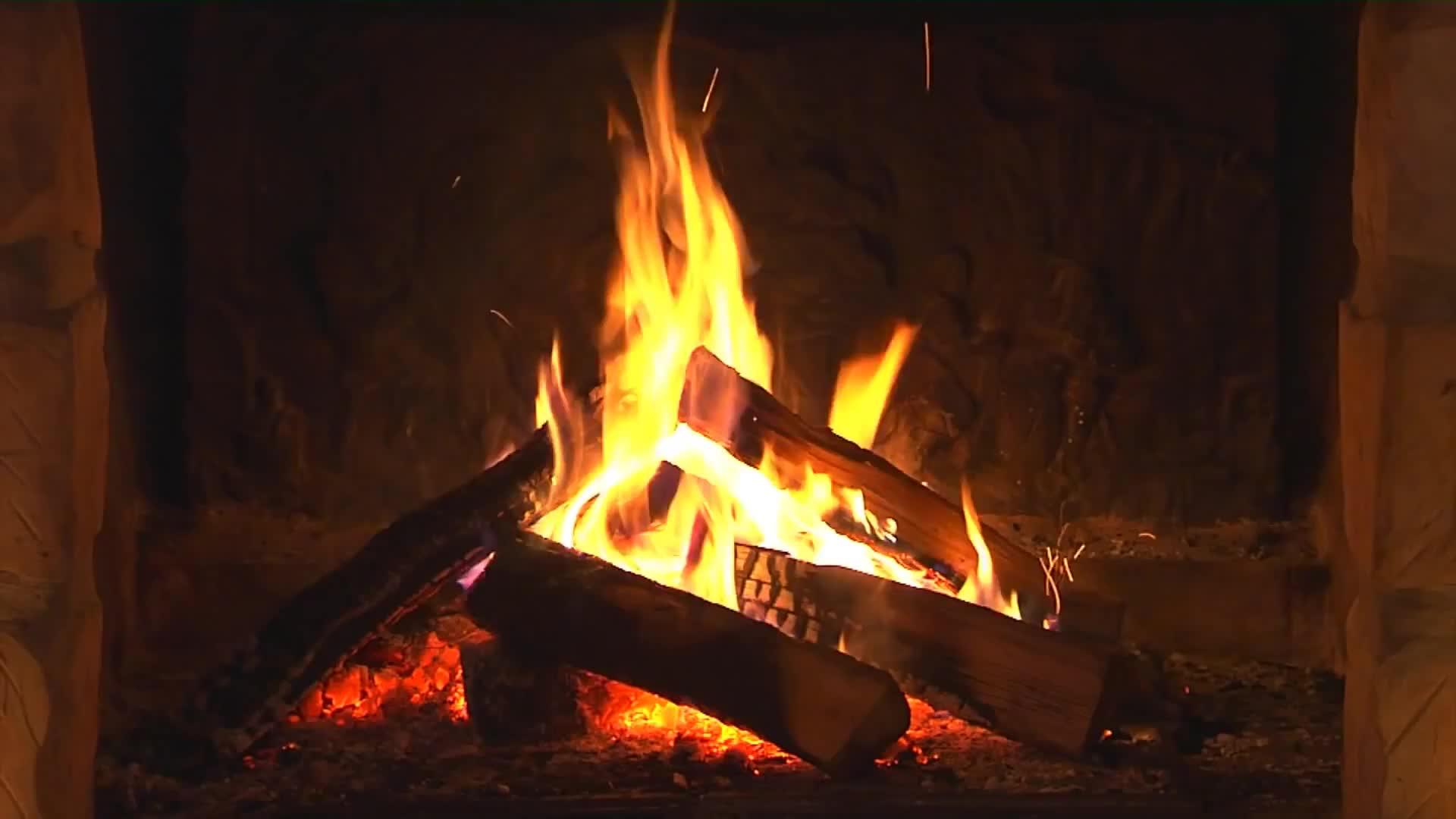 Пламя огня в камине - живые обои