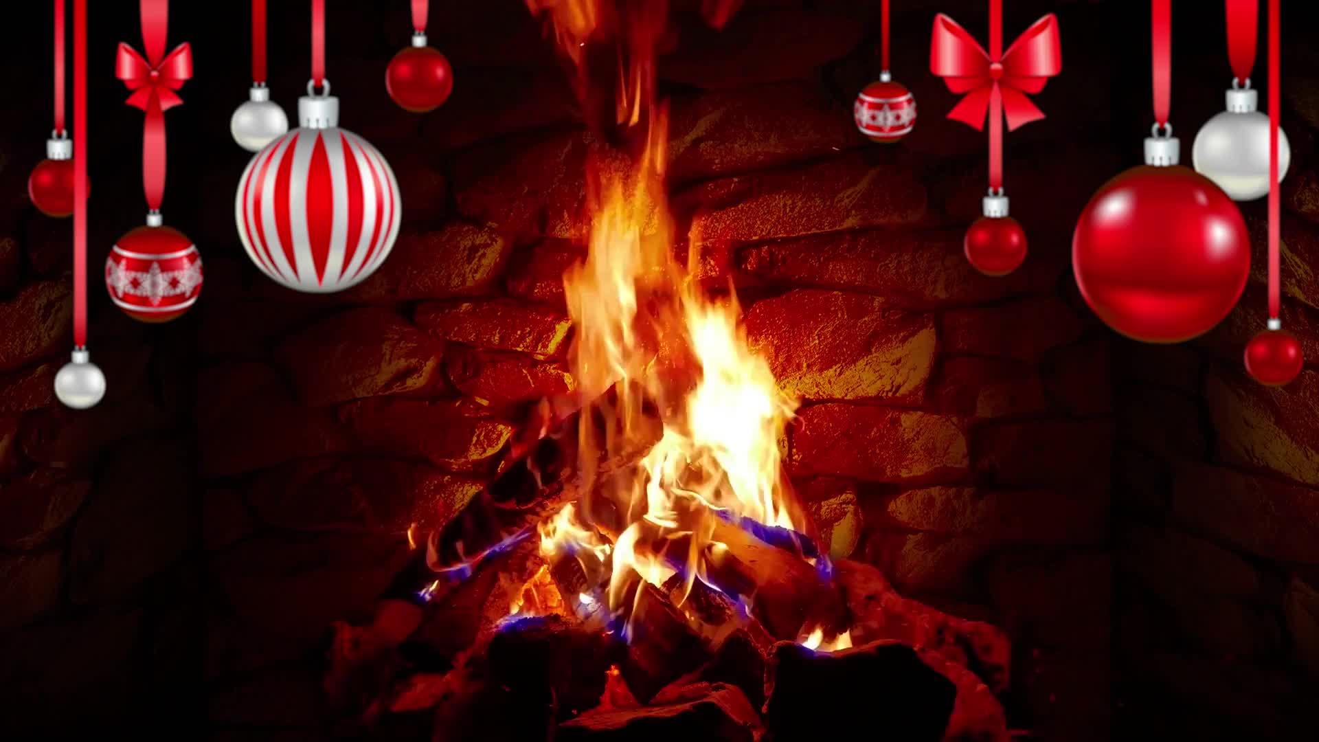Горящий камин и рождественские игрушки - живые обои